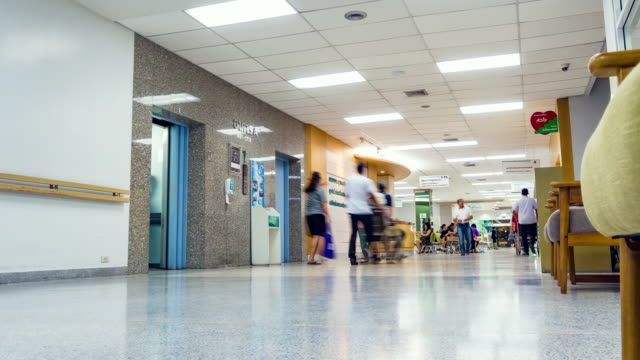 Timelapse, patients moving in the corridor at the hospital. video