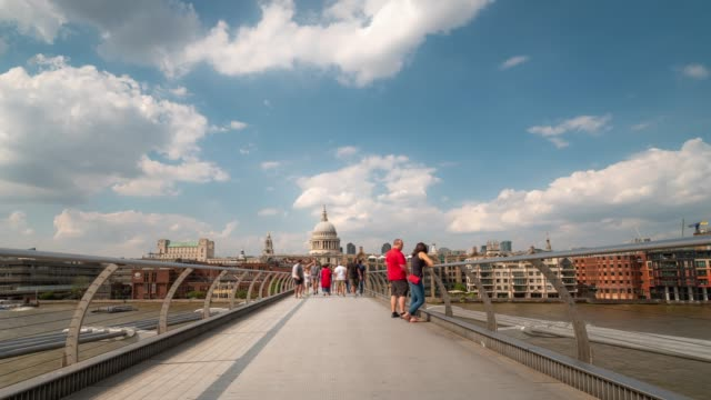 Time-lapse: Pedestrian Commuter Crowd at Millennium Bridge with St Paul's Cathedral in London England UK