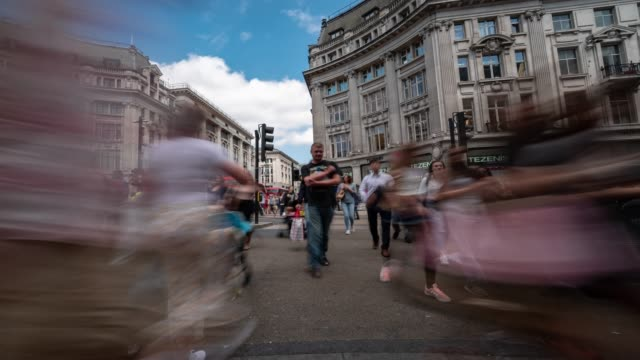 Time-lapse: Pedestrian Commuter Crowd at oxford circus downtown Shopping street in London England UK