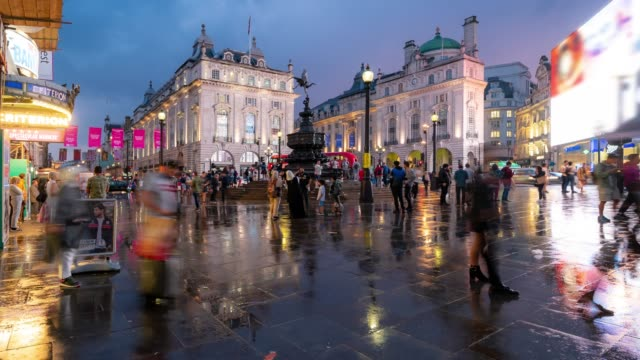 Time-lapse: Pedestrian Commuter Crowd at Piccadilly Circus downtown at night in London England UK