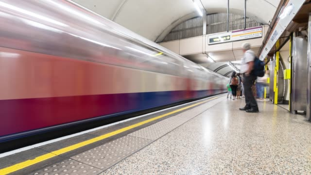 Time-lapse: Pedestrian Commuter Crowd at Subway tube platform in London England UK 4K Time-lapse: Pedestrian Commuter Crowd at Subway tube platform in London England UK, Apple ProRes 422 (HQ) 3840x2160 Format railroad station platform stock videos & royalty-free footage
