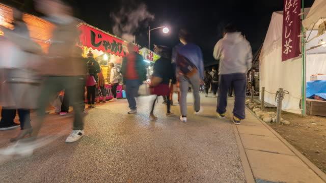 夜こうらんけいフリー マーケット名古屋で混雑時間経過: 歩行者 - トヨタ点の映像素材/bロール
