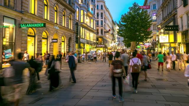 4K Time-lapse: Pedestrian Crowded Kartner shopping street Vienna Austria dusk video