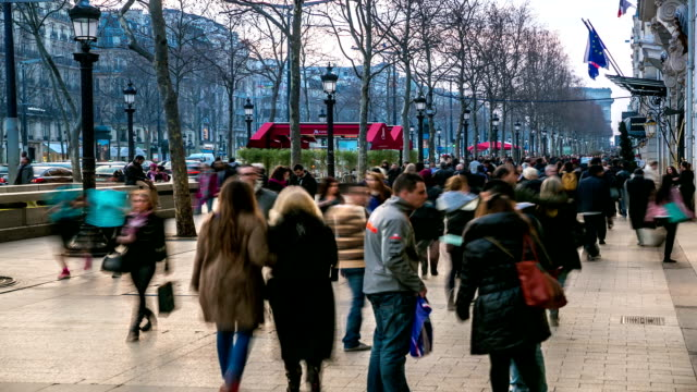 HD time-lapse: Pedestrian Tourist Crowd at champs elysee Paris evening video