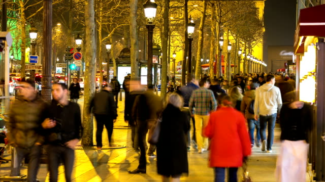 HD time-lapse: Pedestrian Tourist Crowd at champs elysee Paris night video