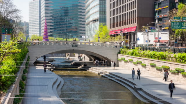 Time-lapse: Pedestrians at Cheonggyecheon canal at Seouk Downtown South Korea 4K Time-lapse: Pedestrians at Cheonggyecheon canal at Seouk Downtown South Korea, Apple ProRes 422 (HQ) 3840x2160 Format korea stock videos & royalty-free footage