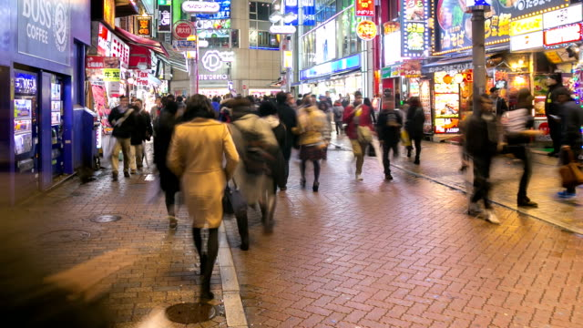 HD Time-lapse: Pedestrians at Shibuya street with raining at dusk video