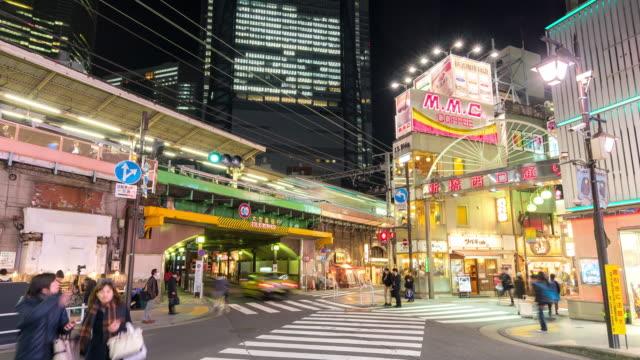 time-lapse: fotgängare trångt på shimbashi hangout district tokyo japan - billboard train station bildbanksvideor och videomaterial från bakom kulisserna