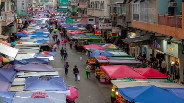 Video Time-lapse: Pedestrians Tourist crowded shopping Fa Yuan flea market, Mongkok, Nathan Road in Kowloon Hong Kong
