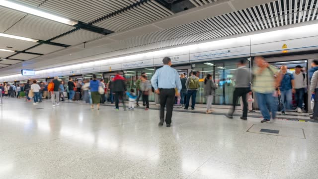Time-lapse: Pedestrians Traveler and tourist Crowd in Subway Metro Train Station in Hong Kong