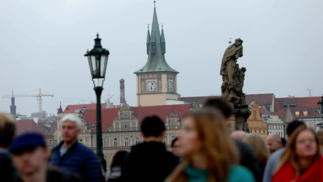 time-lapse people on the Charles Bridge in Prague against the backdrop of the clock tower, Prague, 2017 video