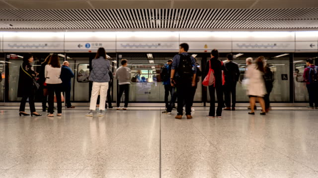 4K Timelapse - People Waiting for Metro Subway, Hong Kong 4K Timelapse - Merto Subway Platform, Hong Kong railroad station platform stock videos & royalty-free footage