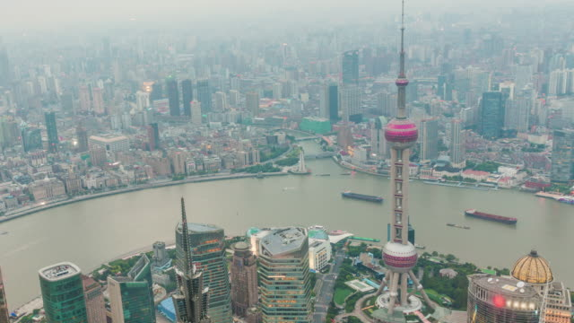 Time-lapse photography Oriental Pearl Tower from dusk to night. located at Lujiazui finance and trade zone in Pudong