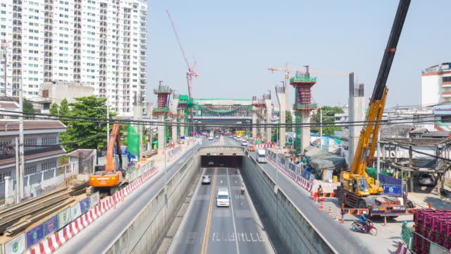 4K Time-lapse: Road traffic and Bridge construction site