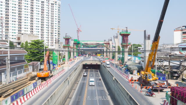 4K Time-lapse: Road traffic and Bridge construction site video