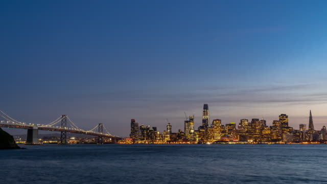 Time-lapse San Francisco downtown skyline at dusk from Treasure Island, California, sunset, USA 4K Time-lapse San Francisco downtown skyline at dusk from Treasure Island, California, sunset, USA, Apple ProRes 422 (HQ) 3840x2160 Format oakland stock videos & royalty-free footage