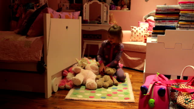 Time-Lapse Sequence Of Girl Arranging Toys In Bedroom video