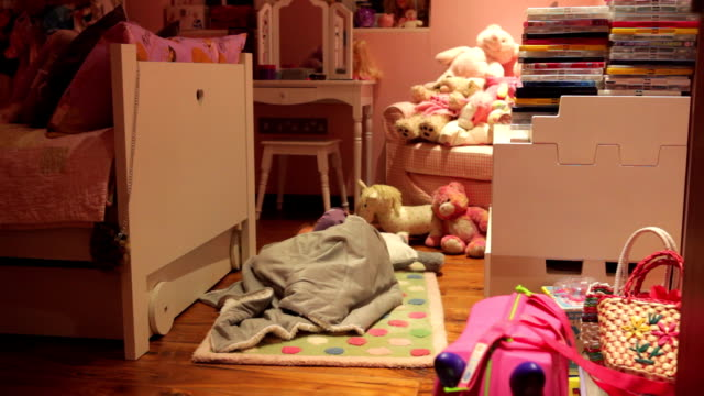 Time-Lapse Sequence Of Girl Moving Toys To Make Bed On Floor video