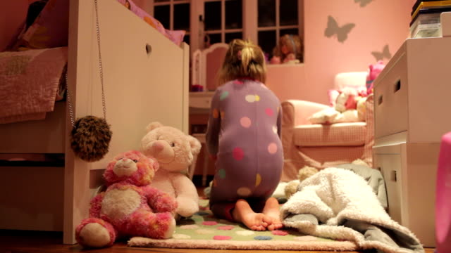 Time-Lapse Sequence Of Girl Playing With Toys In Bedroom video