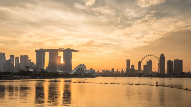 4k time-lapse: singapore cityscape sunset at dusk - singapore architecture stock videos & royalty-free footage