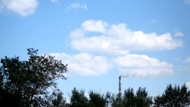 Time-lapse, smoke goes from the chimney. Industrial pipe video