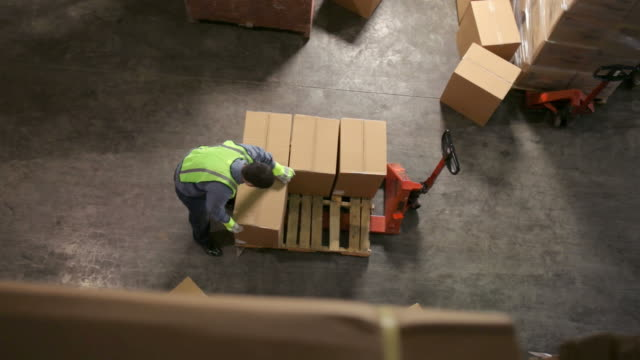 Timelapse, stacking boxes in warehouse video