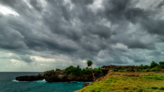 timelapse storm clouds over the nusa ceningan island in cloudy weather, bali, indonesia - monsone video stock e b–roll