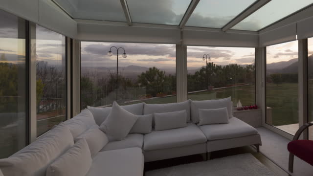 Time-lapse Sunrise in Home 4K Time-lapse video of a winter garden of a home. mansion stock videos & royalty-free footage