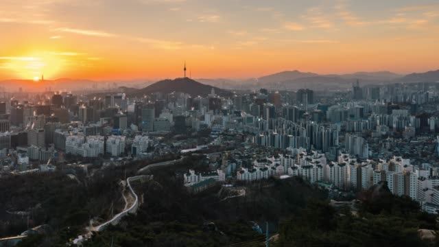 TImelapse sunrise scene of Seoul downtown city skyline TImelapse sunrise scene of Seoul downtown city skyline, Aerial view of N Seoul Tower at Namsan Park in twilight sky in morning. The best viewpoint and trekking from inwangsan mountain in Seoul city, South Korea seoul stock videos & royalty-free footage