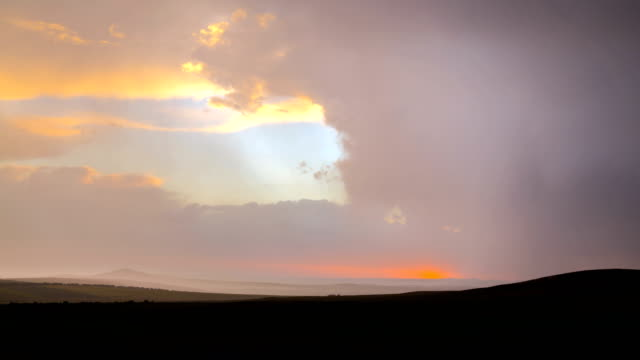 4K Timelapse. Sunset during a thunderstorm against the background of a cloudy sky, in the steppe. video