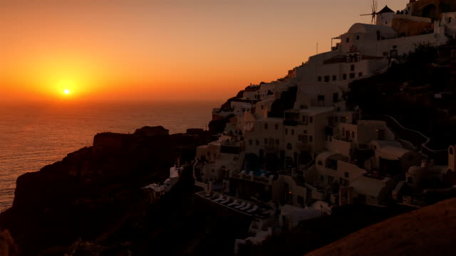Timelapse Sunset in the Mediterranean - Traditional Cycladic Houses and Windmill video