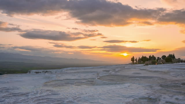 Time-lapse sunset of Pamukkale tranvanter pools at ancient Hierapolis , Denizli
