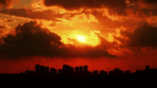 Timelapse  sunset on the cloudy sky over city, Turkey - video