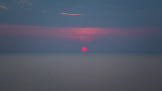 4K Time-lapse : Sunset over the sea Red sun, Tropical Climate,sea,Day to night sunset to night time lapse stock videos & royalty-free footage