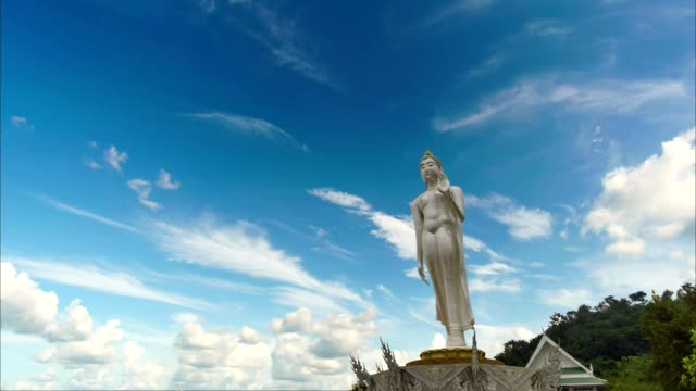 4K time-lapse: thailand buddha statue with background of blue sky and cloud. video