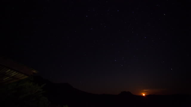 timelapse the moon move behind mountain at Phu Lanka National Park, Phayao province, north of Thailand. video