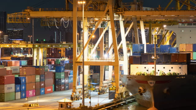 time-lapse : the operation staff that control crane is working to lift the container in the port - nave mercantile video stock e b–roll