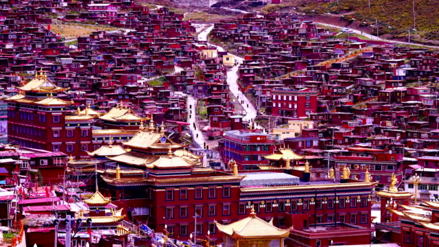 Time-lapse :The red village in valley called seda in sichuan, china