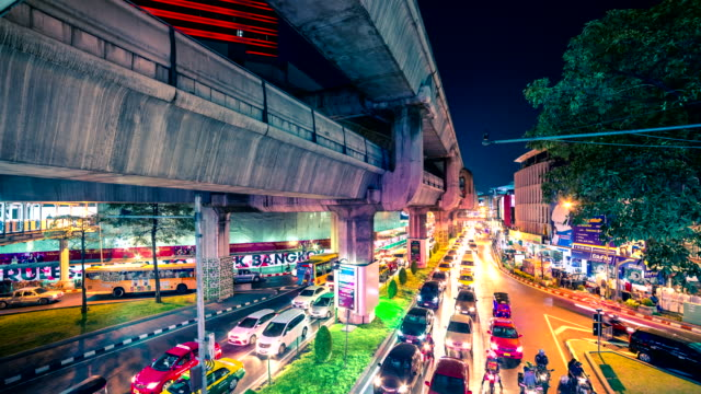 4K TimeLapse. The road with moving cars and top bridge for Skytrain at night in Bangkok, Thailand. January, 2016. video
