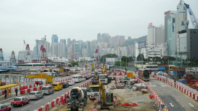 Timelapse tilt down: Transportation construction site working Time-lapse and tilt down of Construction site working in day time. Hong Kong foundation make up stock videos & royalty-free footage