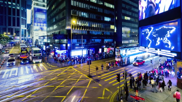 4K Timelapse : Timelapse view of people at a crossing on the streets Hong Kong city at Causway Bay. Hong Kong is a major financial hub in the Asia region. video