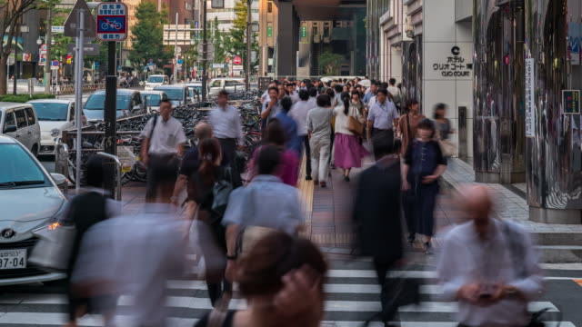 time-lapse tourist crowded and transportation at hakata in fukuoka cityscape downtown japantime-lapse tourist crowded and transportation at hakata in fukuoka cityscape downtown japan - città diffusa video stock e b–roll