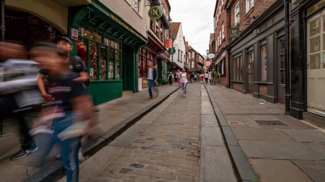 Time-lapse: Tourist Pedestrian Commuter Crowd at York shamble shopping area in York England Uk.