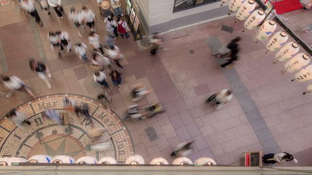 Time-lapse: Tourist pedestrian crowded at Motomachi Shopping street Kobe Japan