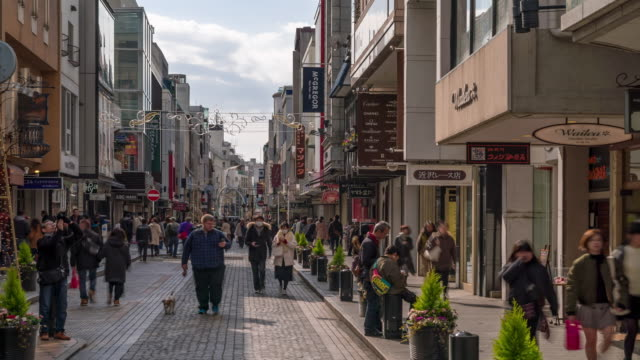 Time-lapse: Tourist pedestrian crowded shopping at Motomachi Shopping street in Yokohama Japan 4K Time-lapse: Tourist pedestrian crowded shopping at Motomachi Shopping street in Yokohama Japan, Apple ProRes 422 (HQ) 3840x2160 Format souvenir stock videos & royalty-free footage