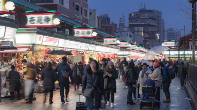 Time-lapse: Tourist Pedestrians shopping around Nakamise Market Asakusa Sensoji Temple sunset