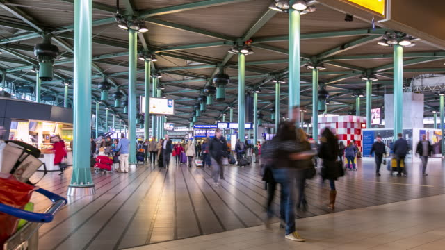 time-lapse: Traveler at Airport Arrival Terminal Schiphol Amsterdam Netherlands video