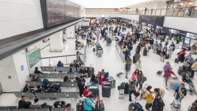 Time-lapse: Traveler crowd at Airport Arrival hall Terminal Narita Japan video