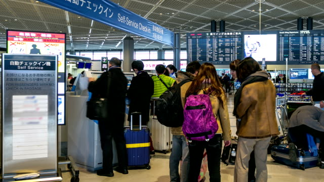 HD Time-lapse: Traveler Crowd at Airport Check-in Kiosk video