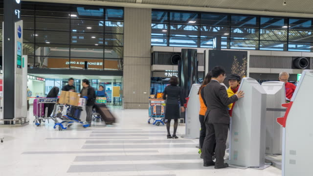 Time-lapse: Traveler Crowd at Airport Check-in Kiosk video
